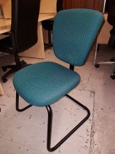 Green and black cantilever meeting chair